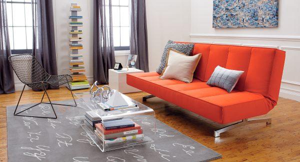 A-bright-orange-sleeper-sofa-in-a-modern-living-room