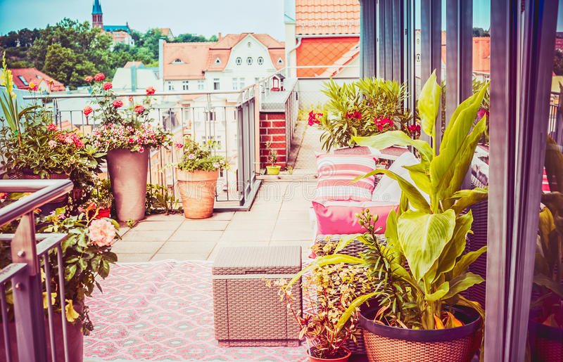 pretty-summer-terrace-balcony-penthouse-flowers-patio-pots-outdoor-furniture-nice-city-view-97449751