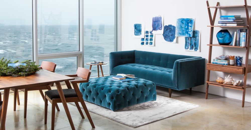 Velvet-sofa-in-blue-with-ottoman